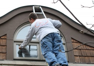 Washing the windows of a Kansas City home